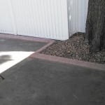 stamped brown concrete curbing